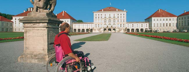 A wheelchair user in the parc of the castle Nymphenburg castle